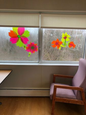 Paper flowers hung on windows at San Simeon by the Sound