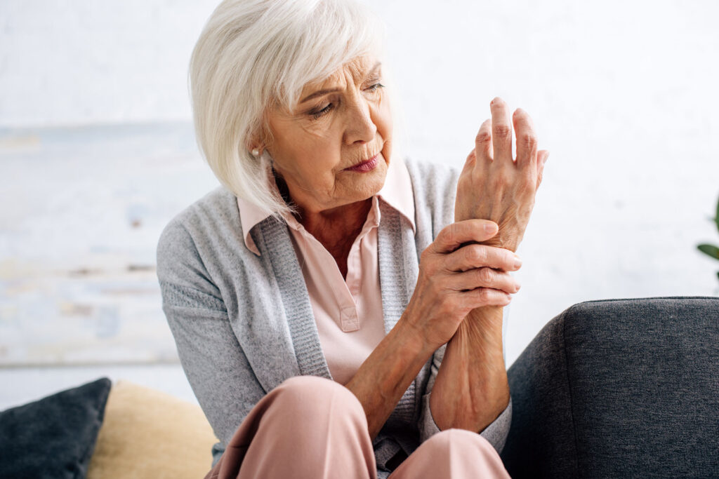 senior woman suffering from arthritis in her wrist