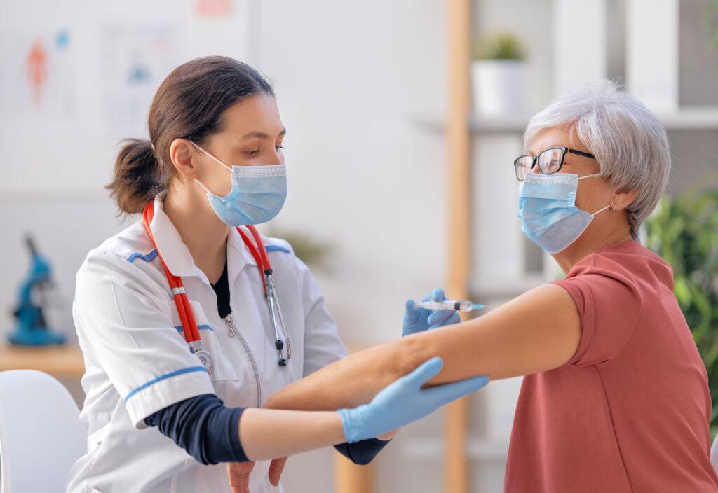 senior woman receiving COVID-19 vaccine