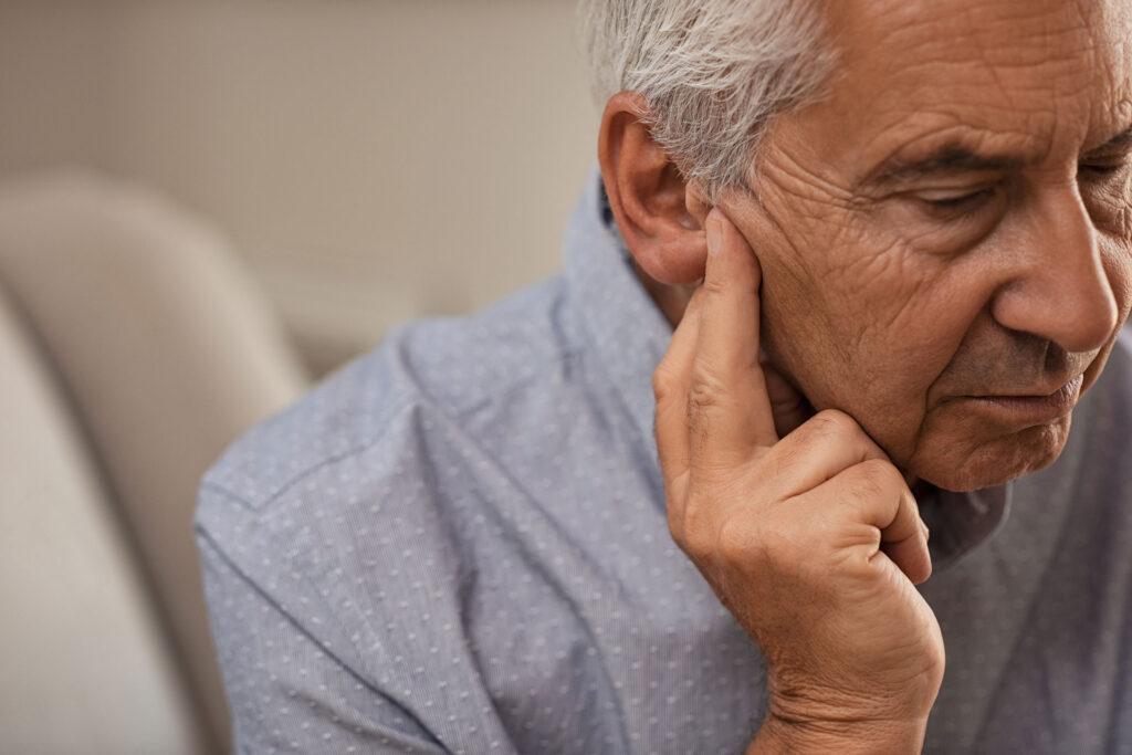 senior male experiencing hearing loss