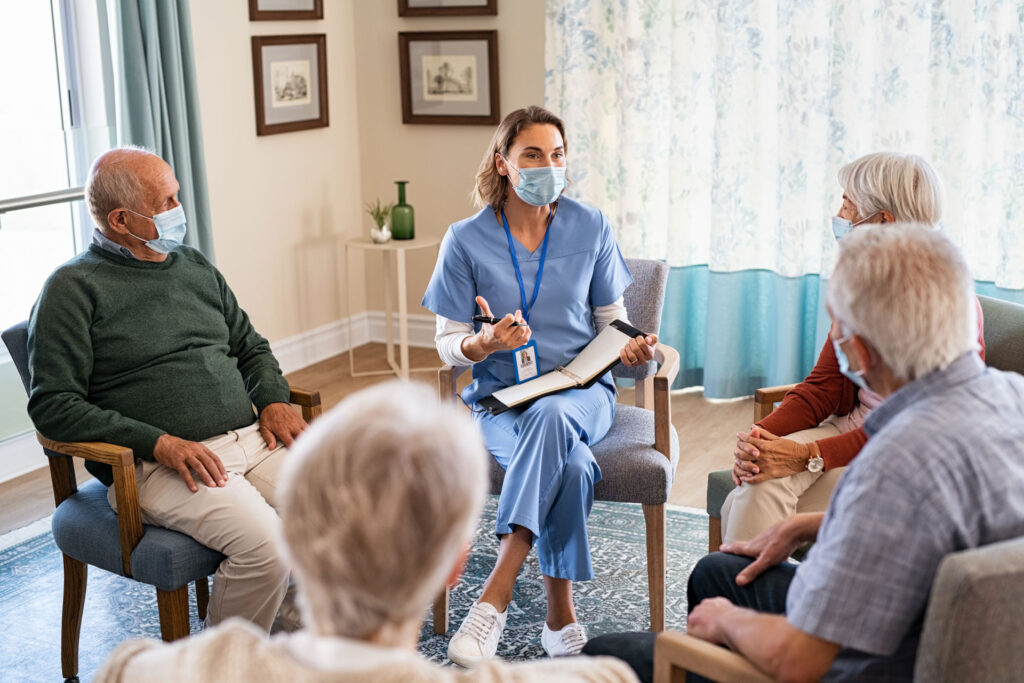 nurse with nursing home residents all wearing masks