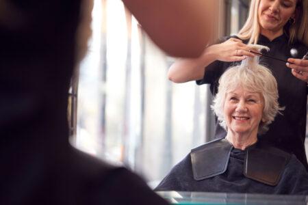 senior woman getting her hair cut