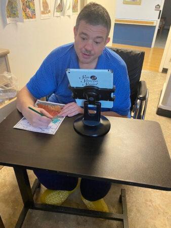 San Simeon male resident using iPad
