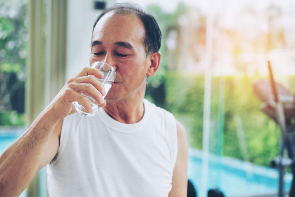senior male drinking water